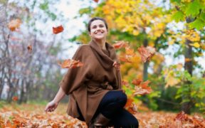 happy-girl-throws-maple-leaves_